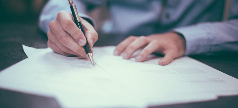 a man signing documents