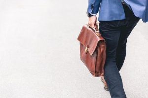 A man carrying a bag while on his way to work.