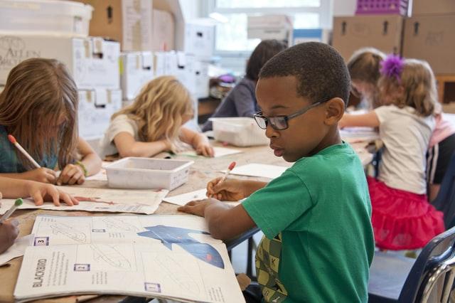Children sitting at the desk in school