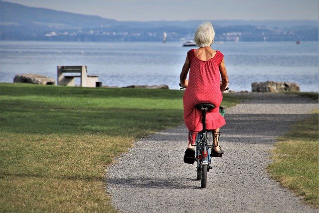 An old woman riding a bicycle in one of the best cities in Florida for senior homebuyers