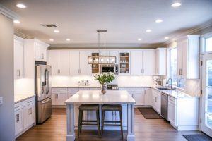 Spacious kitchen painted in white