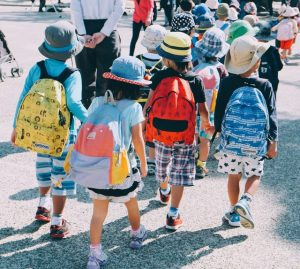 A group of kids going to school