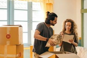 man and a woman packing boxes